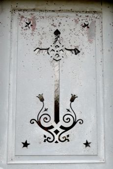 cross on metal door